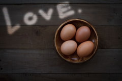 Still life concept by eggs and love.  royalty free stock images
