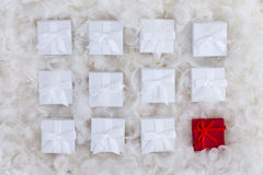 Still life concept of one red and many white gifts Stock Photo