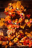 Still life consisting of wicker wreath, orange leaves, autumn be Stock Image