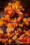 Still life consisting of wicker wreath, orange leaves, autumn be Stock Photo