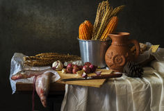 Still life with  cook. Still life Photography with cook, fish  and corn cob on wooden table Stock Image