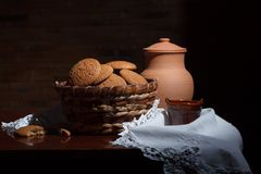 Still life with cookies in a basket Stock Images