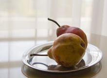 Still life with couple of brown pears on backlight Royalty Free Stock Images