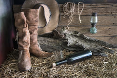 Still life with cowboy hat and leather boots. Still life painting photography with traditional leather boots and american west rodeo brown felt cowboy hat in stock photos