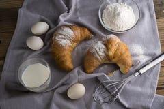 Still life of croissants, eggs, milk and flour. Royalty Free Stock Photo