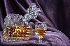 Still life with a crystal decanter and glass Stock Photo