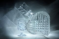 Still life with a crystal decanter and glass Stock Image