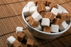 Still life of cubes of white and brown sugar Stock Photos