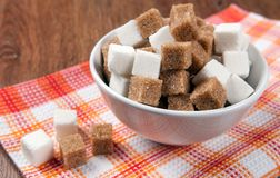 Still life of cubes of white and brown sugar Stock Photo