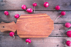 Still life of a cucumber radish on a wooden background. Still life of a cucumber radish on a wooden background Stock Photo