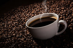 Still-life with a cup of black coffee and roasted coffee beans Stock Photos