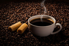 Still-life with a cup of black coffee and roasted coffee beans Royalty Free Stock Photo
