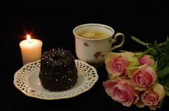 Still life with cup cake and roses and candle. Still life with cup off coffee, cake, candle and roses Stock Photo