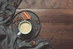 Still life with cup of coffee, warm scarf on wooden board. Copy space. Top view. View from above royalty free stock photo