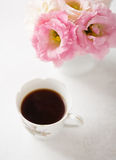 Still life with  cup of coffee  and flowers Royalty Free Stock Images