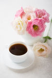 Still life with cup of coffee and flowers Royalty Free Stock Photography