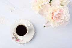 Still life with cup of coffee and flowers. Royalty Free Stock Image