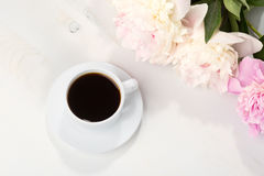 Still life with cup of coffee and flowers. Stock Photos