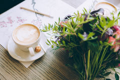 Still life with cup of coffee and flowers Stock Image