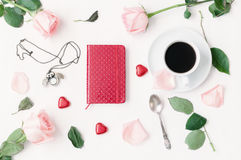 Still life - cup of coffee, peach roses, blank love card and heart shaped candies, love romantic background. Still life - cup of coffee, peach roses, red Stock Photo