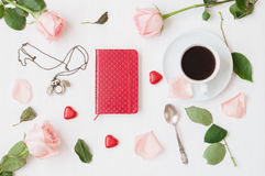 Still life - cup of coffee, peach roses, blank love card and heart shaped candies, love romantic background. Still life - cup of coffee, peach roses, red Stock Images