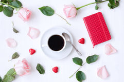 Still life - cup of coffee, peach roses, blank love card and heart shaped candies, love romantic background. Romantic still life - cup of coffee, peach roses Royalty Free Stock Image