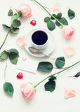 Still life - cup of coffee, peach roses, blank love card and heart shaped candies, love romantic background. Vintage tones applied Stock Photos