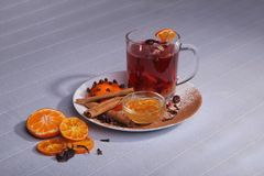 Still life. A cup of drink. Spices and fruits on a plate. royalty free stock image