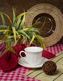 Still life with cup and home flower Stock Photos