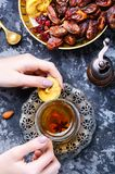 Cup of Turkish tea. Still life with a cup of oriental tea and fig fruits Royalty Free Stock Photography
