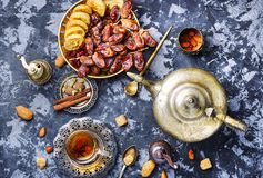 Cup of Turkish tea. Still life with a cup of oriental tea and fig fruits Stock Photography
