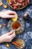Cup of Turkish tea. Still life with a cup of oriental tea and fig fruits Royalty Free Stock Photo
