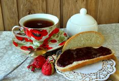 Still life with cup of tea and bread with jam Stock Photos