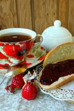 Still life with cup of tea and bread with jam Royalty Free Stock Photo