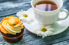 Still life with cup of tea and cake Stock Photo