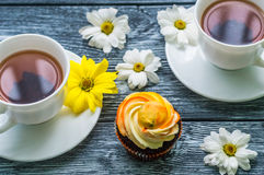 Still life with cup of tea and cake Stock Image