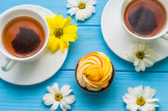 Still life with cup of tea and cake Stock Photography