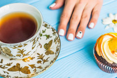 Still life with cup of tea and cake Royalty Free Stock Images