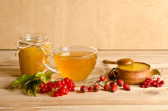 Still life from cup of tea, honey and  berries Royalty Free Stock Images