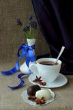 Still life with cup of tea, sweets and spring flowers Stock Image