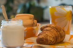 Still life cup of tea, yogurt, muffins, cookies royalty free stock image