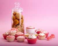 Still life of cupcakes with flower Stock Photos