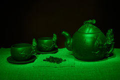 Still life with cups, saucers, a tea infuser of handmade clay Royalty Free Stock Images