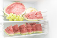 Still life: Cut Ningxia watermelon and green grapes. Chinese Ningxia watermelon and grapes installed in the refrigerator Royalty Free Stock Photo