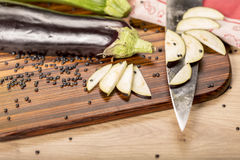 Still life with cutted eggplant slices Stock Photos