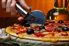 Still-life of cutting pizza Royalty Free Stock Image