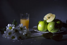Still life with daisies and apples. Still life with field flowers and green apples Stock Image
