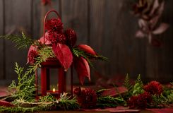 Still life on a dark background. Decor of candles and candlestic Stock Images