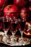 Still life on a dark background. Wine (liquor) glasses, fruits a Royalty Free Stock Photo