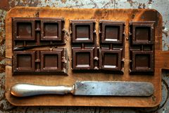 Still life with dark chocolate on a wooden board Stock Photo